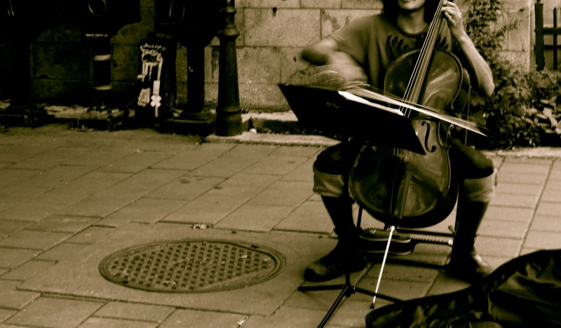 busking street cellist in Montreal