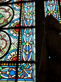 Catherine de Medici statue silhouette in front of stain glass, Saint Denis Basillica, Paris