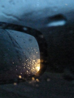 Car side view mirror moving in rain