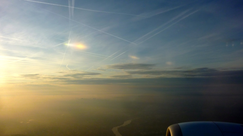 Jet trails from a plane over Paris