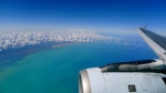 Photo taken out plane window of tropical turquoise waters, sea, ocean