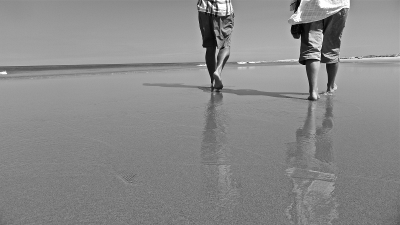 couple walking on beach Australia