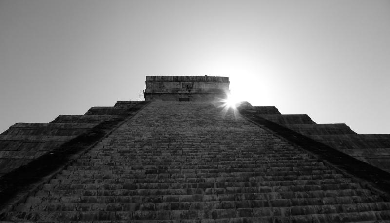Sun rising behind Temple of Kukulkan/El Castillo in Chichen Itza, Mexico 2012