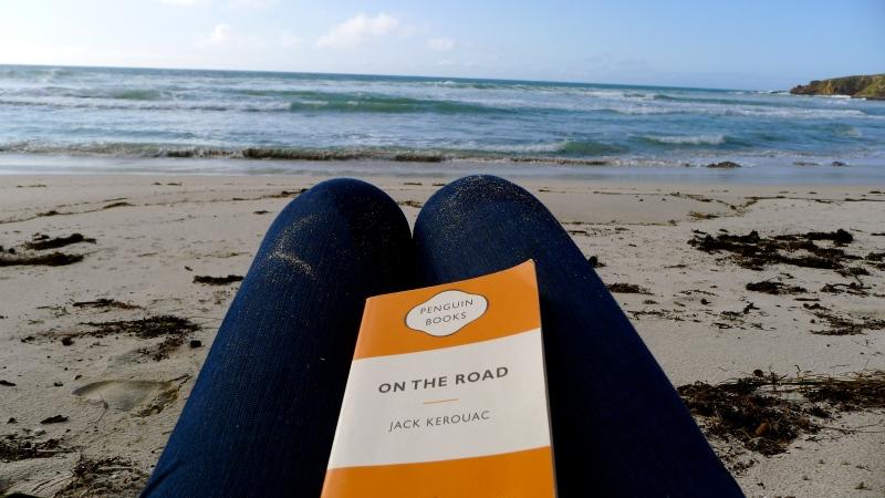 reading on an Australian beach, sunset