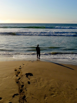 Man stands alone on beach, Kangaroo Island, South Australia
