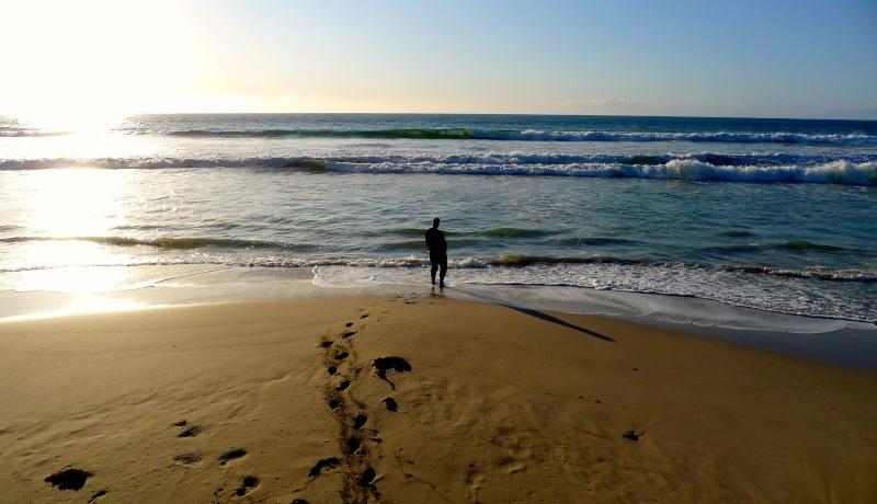 Man stands alone on beach, Kangaroo Island, South Australia